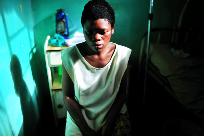 Chibalonza, 26, sits in the hospital in Walungu, South Kivu, in Eastern Congo, April 14, 2008. Chibalonza was kidnapped by six men in uniforms and brought to the forest for nine months, where she was raped repeatedly. (Credit: Lynsey Addario)